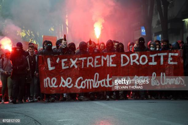 Demonstartors march behind a banner which translates as 'The Extreme Right you can't fight at the ballot box' as they stage a protest against the...