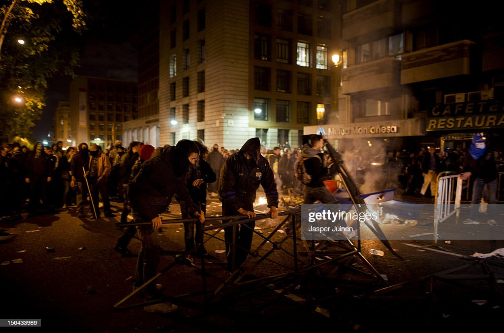 Demonstraters build barricades after a demonstration near the Spanish parliament turned violent on November 14, 2012 in Madrid, Spain. A coordinated general strike by unions in Spain and Portugal has paralysed public transport in the two countries with further strikes planned across Europe. The strike against the governments' austerity measures have force hundreds of flights to be cancelled and factories and ports to come to a standstill.