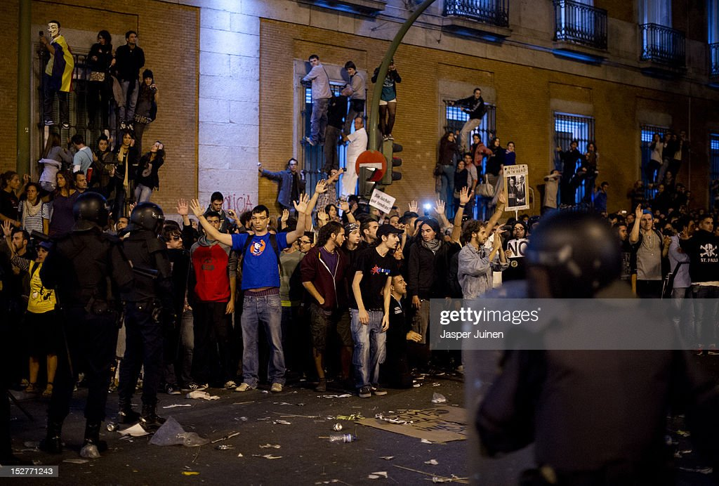 Demonstraters shout at riot policemen during a protest, against spending cuts and the government of Mariano Rajoy, that ended in riots around the Spanish parliament on September 25, 2012 in Madrid, Spain. Demonstrators from various organizations, demanding a new constitutional process, are marching today from three different locations in the center of Madrid to the lower house in the Spanish parliament.