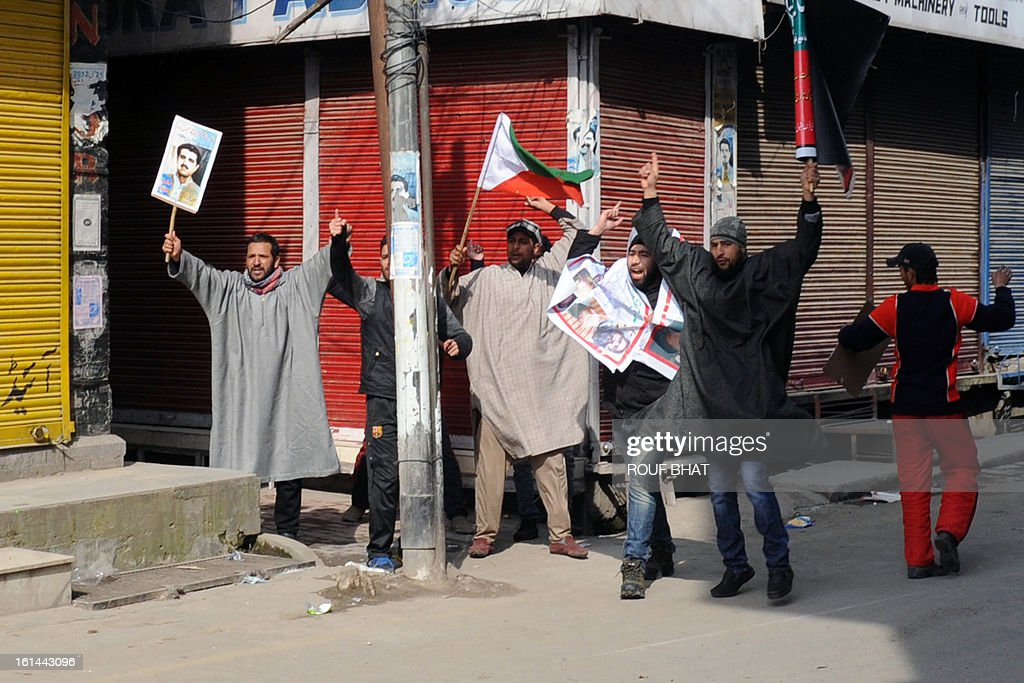 Demonstrating pro-independence Jammu and Kashmir Liberation Front (JKLF) activists shout slogans as they defy a curfew in Srinagar on February 11, 2013. Security forces have imposed a curfew in much of Indian Kashmir following the execution February 9 of Mohammed Afzal Guru, convicted of helping to plot the deadly 2001 attack on the Indian parliament, while a general strike was in force on Monday to mark the 29th anniversary of the execution of Maqbool Bhat, a leader of the Jammu Kashmir Liberation Front (JKLF). AFP PHOTO/Rouf BHAT