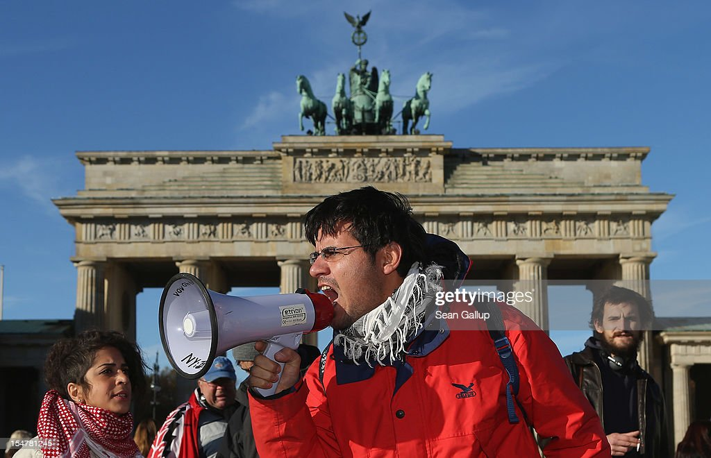 Demonstrating refugees protest during a hunger strike in front of the Brandenburg Gate on October 26, 2012 in Berlin, Germany. The demonstrators, predominantly from Iran, Afghanistan and Iraq, are subsisting on only water, tea and coffee without sugar. They have been sitting in front of the Brandenburg Gate since October 24, and say they will continue their strike until the German government responds to their demands for a halt to deportations and faster processing of asylum applications.