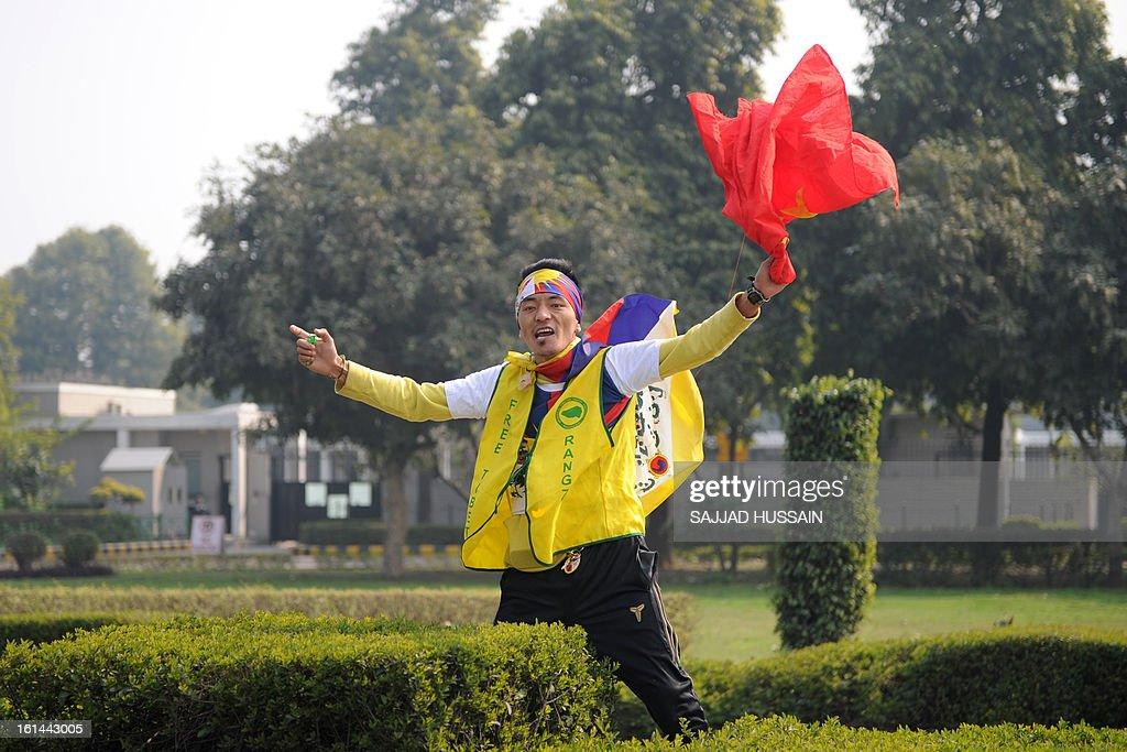 A demonstrating Tibetan exile shouts slogans outside the Chinese embassy during Losar, the Tibetan new year, in New Delhi on February 11, 2013. Lobsang Sangay, the Tibetan prime minister in exile, has called for traditional Losar (the Tibetan new year) celebrations to be shelved as a mark of respect to the nearly 100 people who have set themselves on fire in the last three years. AFP PHOTO/ SAJJAD HUSSAIN