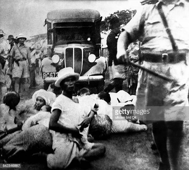 Demonstration against the British colonial rule Demonstrators are blocking a road in Rangoon 1939 photographer Wolfgang Weber
