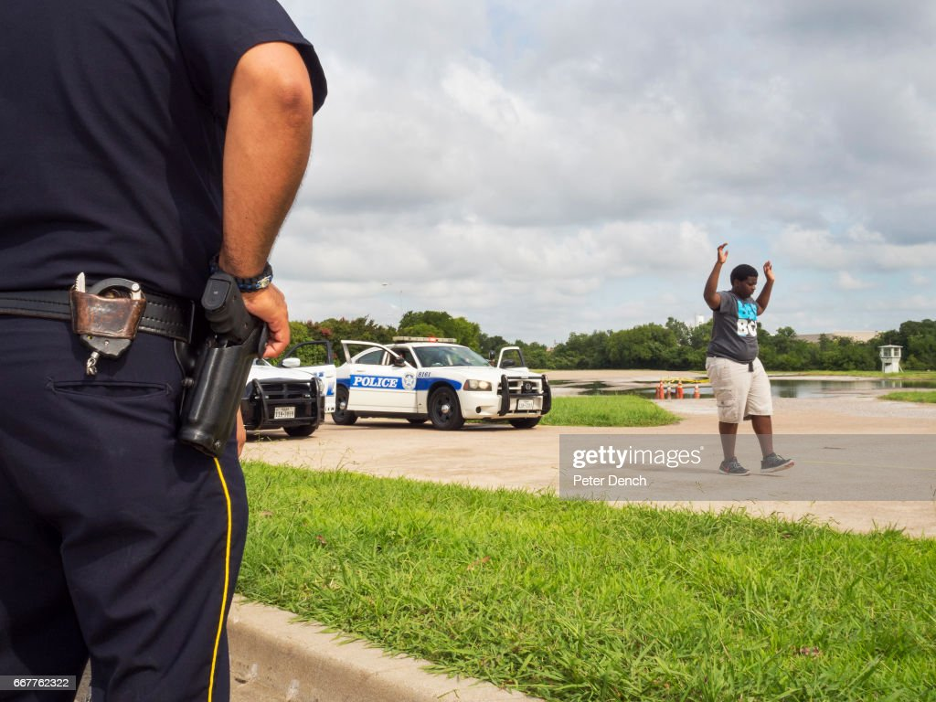 A demonstration of a Felony Traffic Stop by Dallas Police Explorers [DPE]. ..The DPE program is designed to acquaint young people with the nature and complexity of law enforcement...Dallas is a major city in Texas and is the largest urban center of the fourth most populous metropolitan area in the United States. The city ranks ninth in the U.S. and third in Texas after Houston and San Antonio. The city's prominence arose from its historical importance as a center for the oil and cotton industries, and its position along numerous railroad lines. For two weeks in the summer of 2015, photographer Peter Dench visited Dallas to document the metroplex in his epic reportage, DENCH