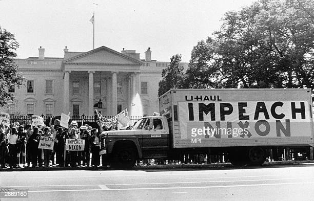 A demonstration outside the Whitehouse in support of the impeachment of President Nixon following the watergate revelations