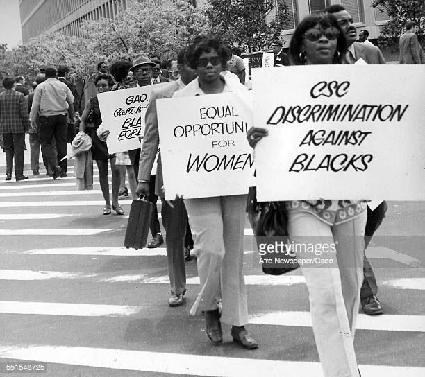 Demonstrations a peaceful march through a city AfricanAmericans carrying banners protesting against discrimination and for equal opportunities for...