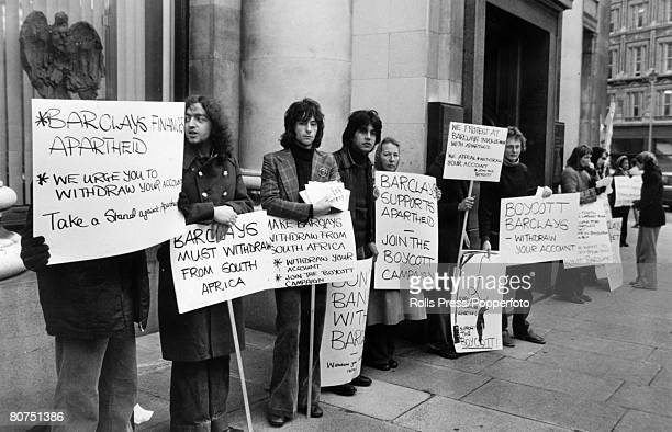 March 1978 London AntiApartheid demonstrators picket Barclays Bank near Trafalgar Square asking account holders to withdraw their accounts claiming...