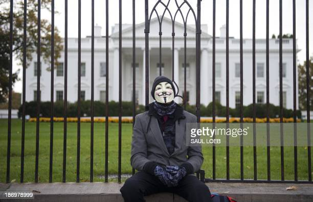 A demonstrator and supporter of the group Anonymous rests during a protest against corrupt governments and corporations in front of the White House...