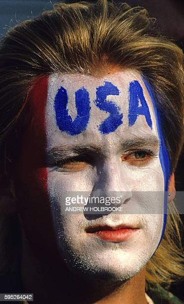 Demonstrator at antiGulf War rally with the letters USA painted on his face