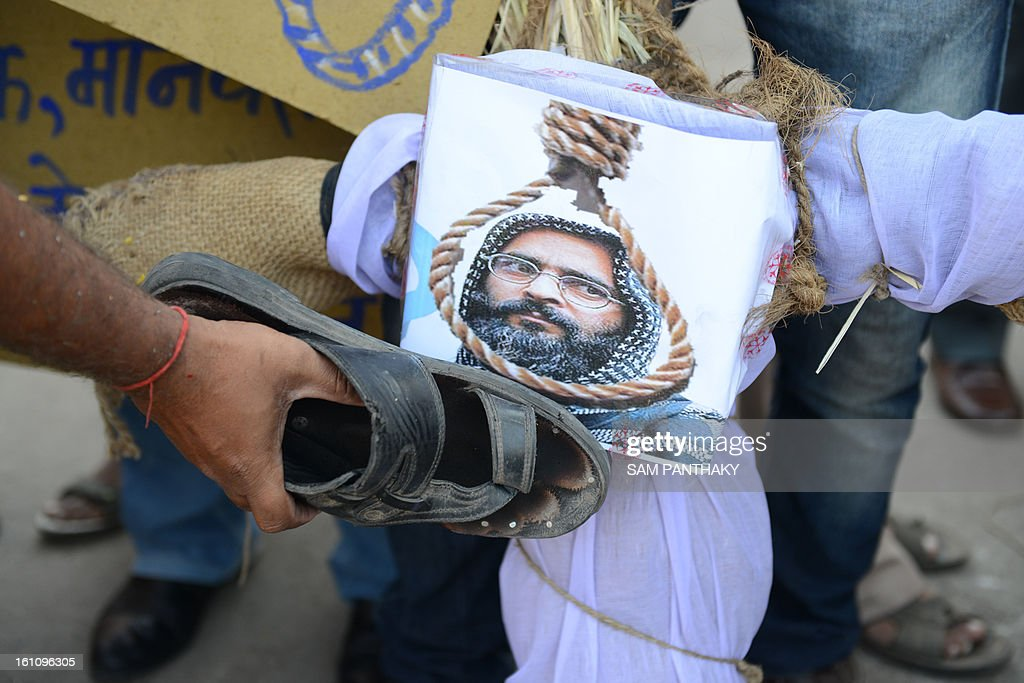 A demonstrator beats an effigy of Mohammed Afzal Guru following his execution, in Ahmedabad on February 9, 2013. A Kashmiri separatist was executed Saturday in New Delhi over his role in a deadly attack on parliament in New Delhi in 2001, an episode that brought nuclear-armed India and Pakistan to the brink of war. AFP PHOTO / Sam PANTHAKY