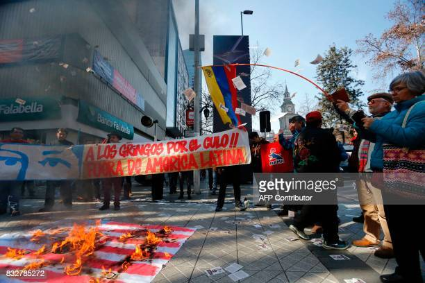 Demonstrator burn a US flag during a protest against the visit of US vice president Mike Pence in Santiago on August 16 2017 Pence is in a twoday...