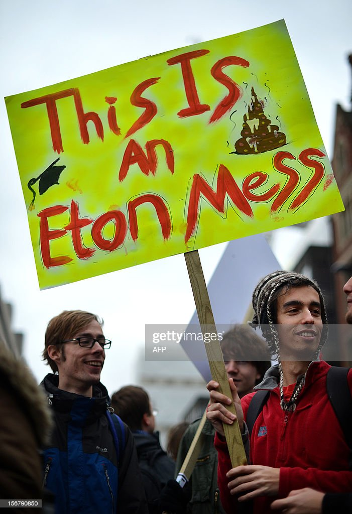 A demonstrator carries a placard before the start of a student rally in central London on November 21, 2012 against sharp rises in university tuition fees, funding cuts and high youth unemployment.