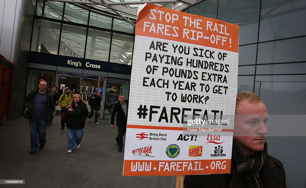 A demonstrator carries a placard protesting rail fare increases outside Kings Cross station on January 2, 2013 in London, England. Rail fares have today risen by an average of 4.2% in England, Scotland and Wales, the tenth year in a row that fares have increased above inflation.