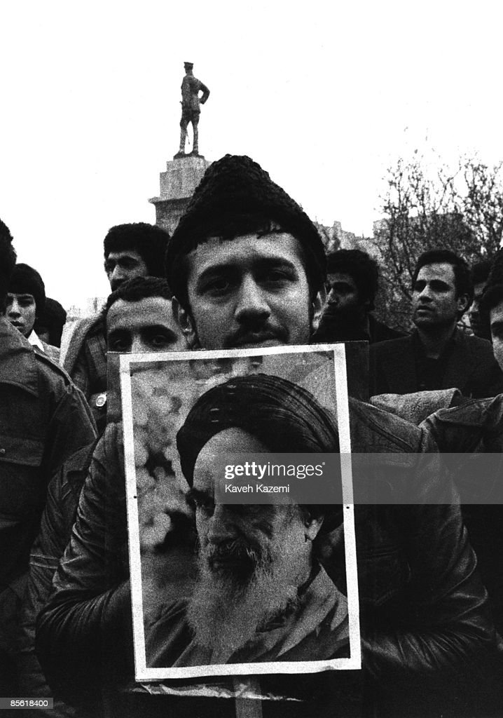 A demonstrator carries a poster of Ayatollah Khomeini in 24 Esfand Square (later Enghelab Square) in Tehran, 10th December 1978. As many as 17 million people up and down the country went on marches to demand the removal of the Shah and the return of Khomeini.