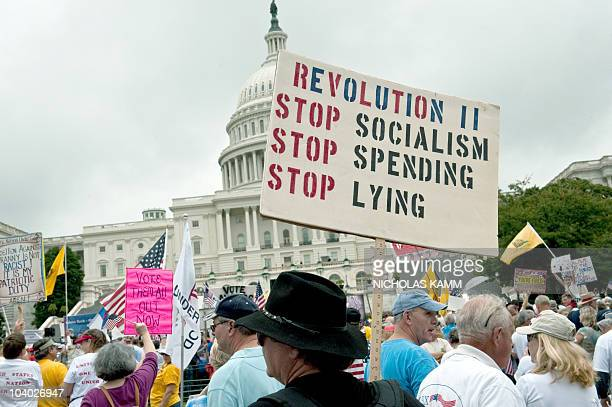 A demonstrator carries a sign calling for a second American revolution to bring an end to alleged Socialism spending and lying in front of the US...