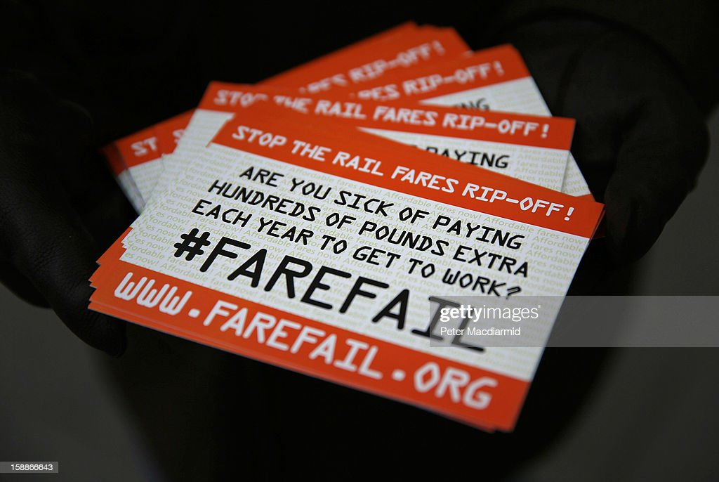 A demonstrator carries spoof tickets protesting rail fare increases outside Kings Cross station on January 2, 2013 in London, England. Rail fares have today risen by an average of 4.2% in England, Scotland and Wales, the tenth year in a row that fares have increased above inflation.