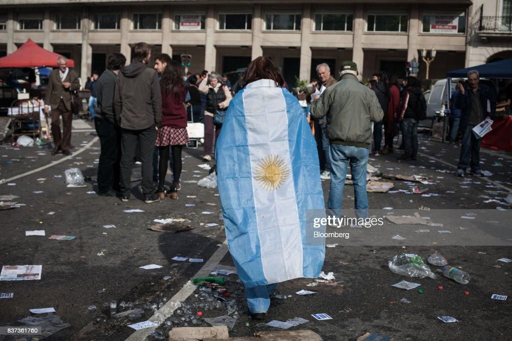 A demonstrator carries the Venezuelan flag during a protest in Buenos Aires, Argentina, on Tuesday, Aug. 22, 2017. Union groups protested Argentinean President Mauricio Marcri's economic policies. Photographer: Erica Canepa/Bloomberg via Getty Images