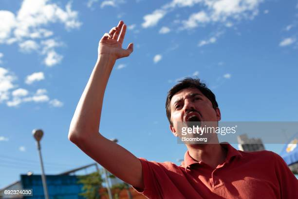 A demonstrator chants during a protest against Brazilian President Michel Temer and government corruption at Largo da Batata in Sao Paulo Brazil on...