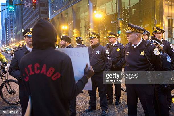 A demonstrator confronts police during a march through downtown on December 12 2015 in Chicago Illinois A recently released video showing the...