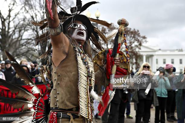 A demonstrator dances in front of the White House during a protest against the Dakota Access Pipeline in Washington DC US on Friday March 10 2017 The...