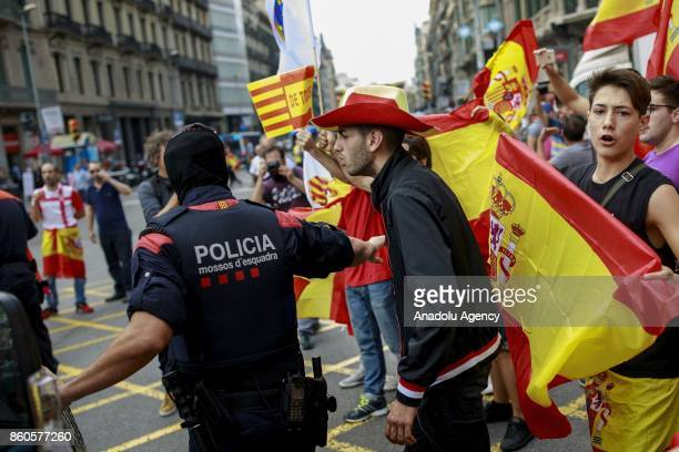 A demonstrator discusses Catalonian autonomous police officers during a demonstration supporting Spain unity on October 12 2017 in Barcelona Spain...