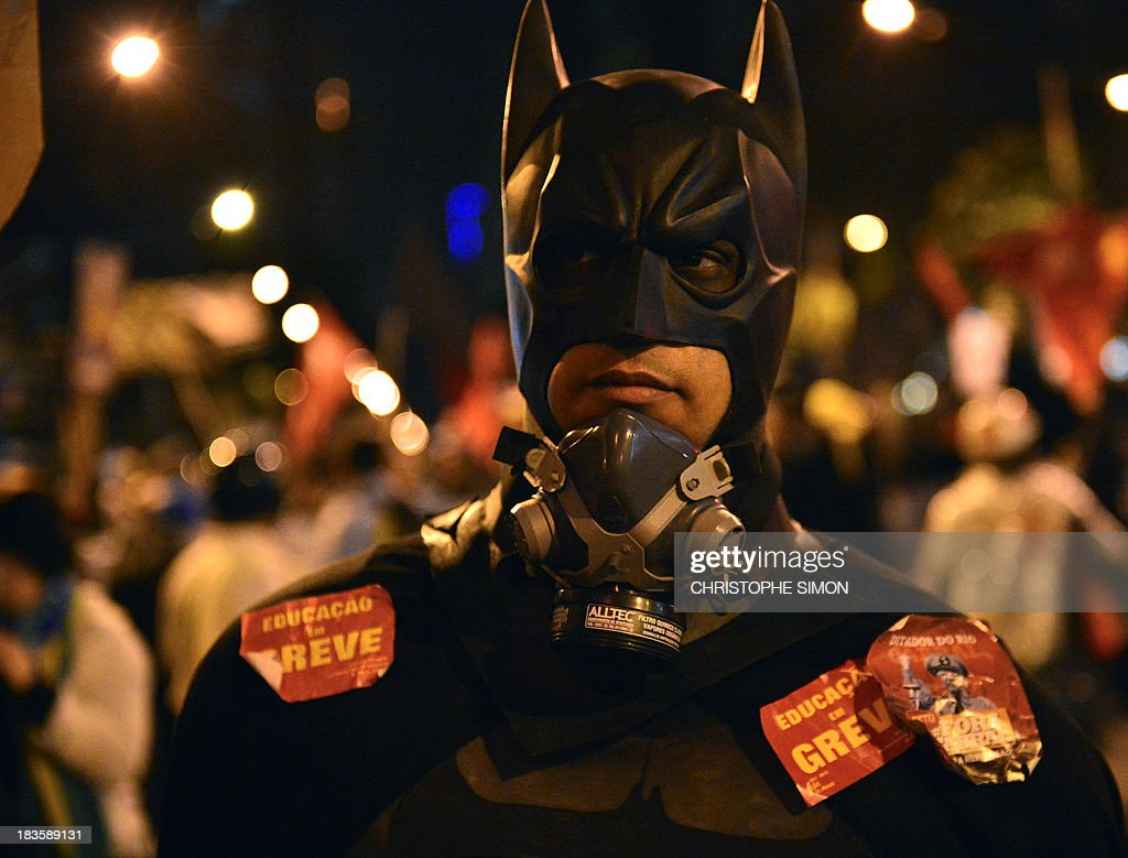 A demonstrator disguised as comic character Batman marches during a teachers protest demanding better working conditions and against police beating, on October 7, 2013 in Rio de Janeiro.