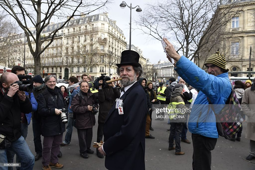 A demonstrator dressed as a banker caricature poses on February 8, 2016 in Paris during a demonstration against bank system and tax fraud, as former French budget minister Jerome Cahuzac goes on trial on February 8 for tax fraud. Cahuzac resigned in disgrace in 2013 after admitting to having a secret Swiss bank account, and faces up to seven years in jail and two million euros ($2.2 million) in fines. AFP PHOTO / MIGUEL MEDINA / AFP / MIGUEL MEDINA