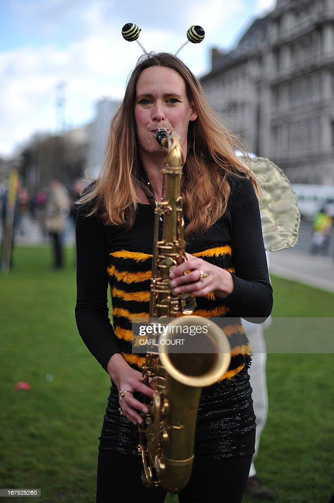 A demonstrator dressed as a bee plays a saxophone as she takes part in a protest against the use of pesticides which are deemed harmful to bees, in central London on April 26, 2013. Together with celebrities including Vivienne Westwood and Katharine Hamnett, protesters are urging Secretary of State for Environment Owen Paterson to not block the EU proposal to suspend the use of certain pesticides. The demonstration comes ahead of a vote in Brussels which will decide whether Europe agrees to introduce a two-year moratorium on the use of certain types of nenicotinoid pesticides.