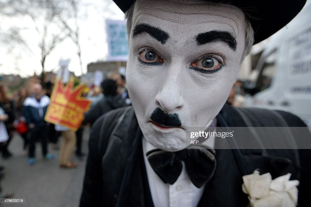 A demonstrator dressed as Charlie Chaplin joins an antifracking protest in London on March 19 2014 Activists and demonstrators joined the Fracked...