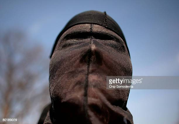 A demonstrator dresses as a 'detainee' during a rally to 'demand Congressional action to stop torture' by The Washington Region Religious Campaign...