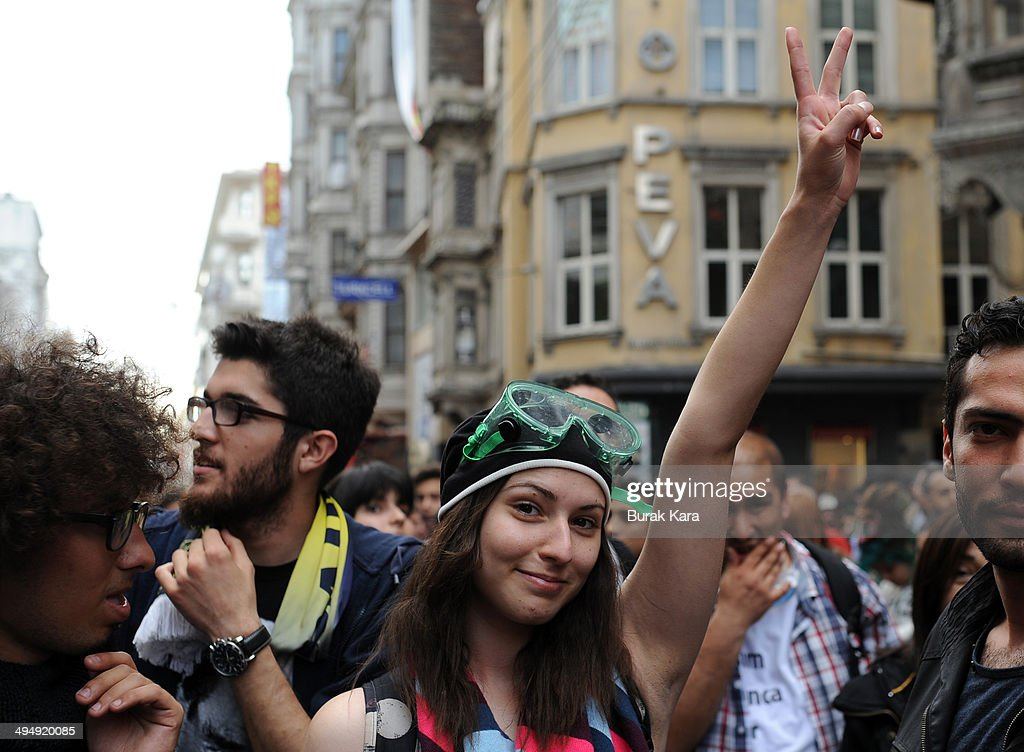 A demonstrator flashes a V sign during anti-government protests in central Istanbul May 31, 2014. Turkish police on Saturday used tear gas in central Istanbul to disperse protesters seeking to mark the one-year anniversary of the start of the biggest anti-government demonstrations in decades. Several hundred people gathered on streets leading to Taksim Square, shouting for the government's resignation, when police fired teargas at the crowd, which quickly scattered.