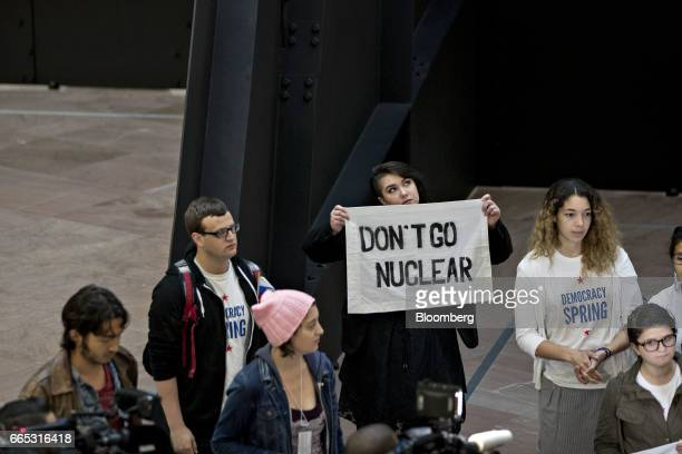 A demonstrator from Democracy Spring holds a 'Don't Go Nuclear' sign while protesting Neil Gorsuch's appointment to the Supreme Court and that...