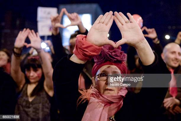 Demonstrator gestures during a rally for International Women's Strike Marchers calling for the end of the violence on women and equal rights