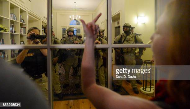 A demonstrator gives the middle finger to sheriff deputies during a rally for the removal of a Confederate statue coined Silent Sam on the campus of...
