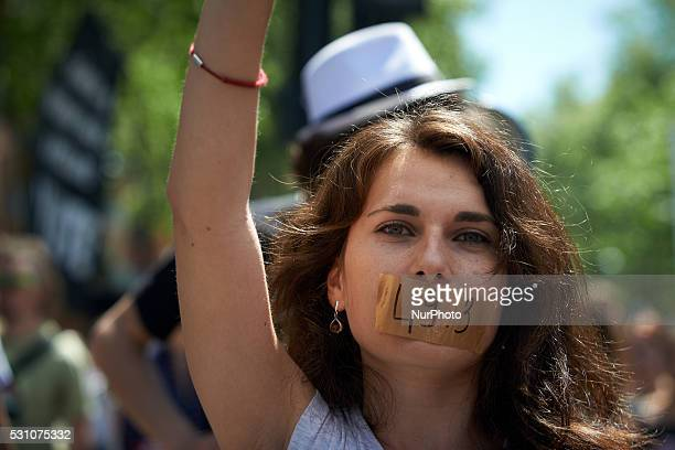 A demonstrator has her mouth shut by a scotchtape reading '493' during a demonstration against the ElKhomri bill and the use of article 493 by...