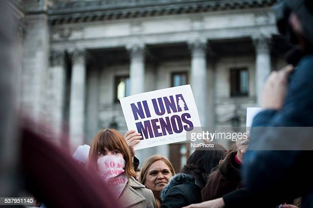 Demonstrator hold placard with a phrase that reads in English quotnot even one lessquot during a march against domestic violence outside the National...