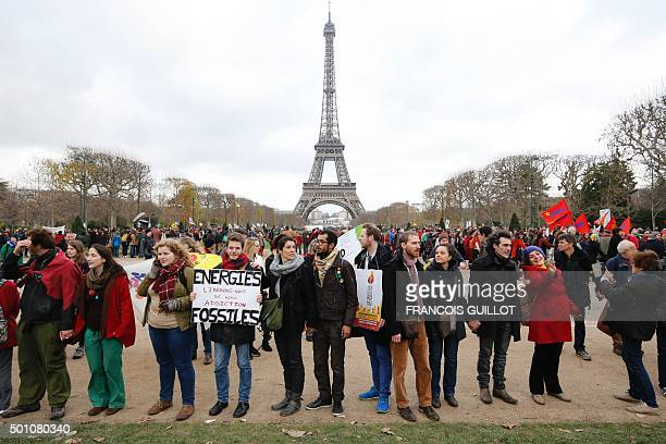 A demonstrator holds a banner reading 'Energy liberateourselves from our fossil addictions' during a rally called by several Non Governmental...