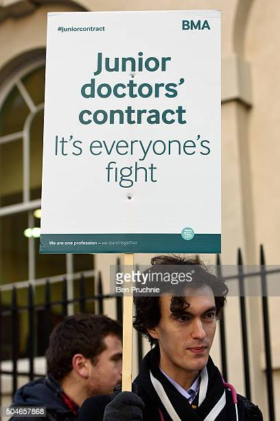 A demonstrator holds a banner with the slogan 'Junior doctors contract it's everyone's fight' outside Guy's hospital as junior doctors nationwide...