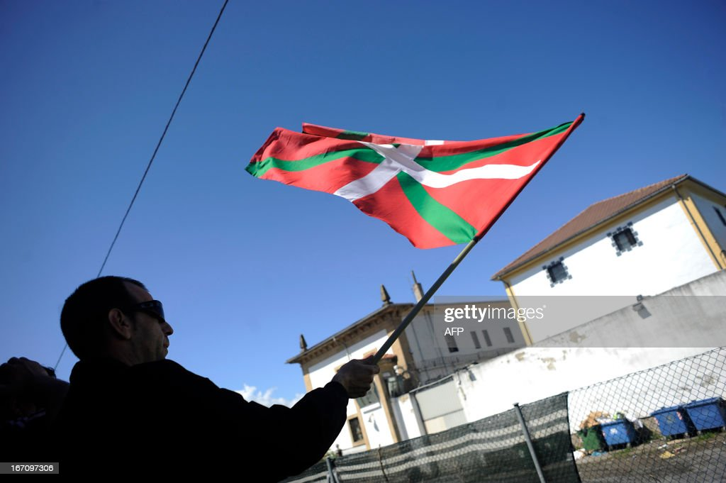 A demonstrator holds a Basque's flag during a march against the arrest of eight members of the Basque pro-independence youth organization SEGI in the northern Spanish Basque city of San Sebastian on April 20, 2013. Hundreds of people took part in the march from the 'Askegunea' square, where six members of SEGI were arrested on April 19, to Martutene's prison in San Sebastian. Spain's supreme court sentenced SEGI's members Mikel Arretxe, Imanol Vicente, Naikari Otaegi, Egoi Alberdi, Aitor Olaizola, Adur Fernandez, Oier Lorente y Ekaitz Ezkerra to six years in jail on April 8 for membership in an organized armed group. AFP PHOTO / ANDER GILLENEA