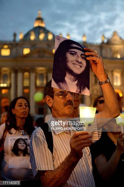 A demonstrator holds a candel during a commemoration of the 30th anniversary of Emanuela Orlandi disappearance in St Peter's Square at the Vatican on...