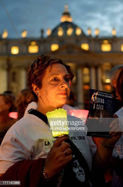 A demonstrator holds a candle during a commemoration of the 30th anniversary of Emanuela Orlandi disappearance in St Peter's Square at the Vatican on...