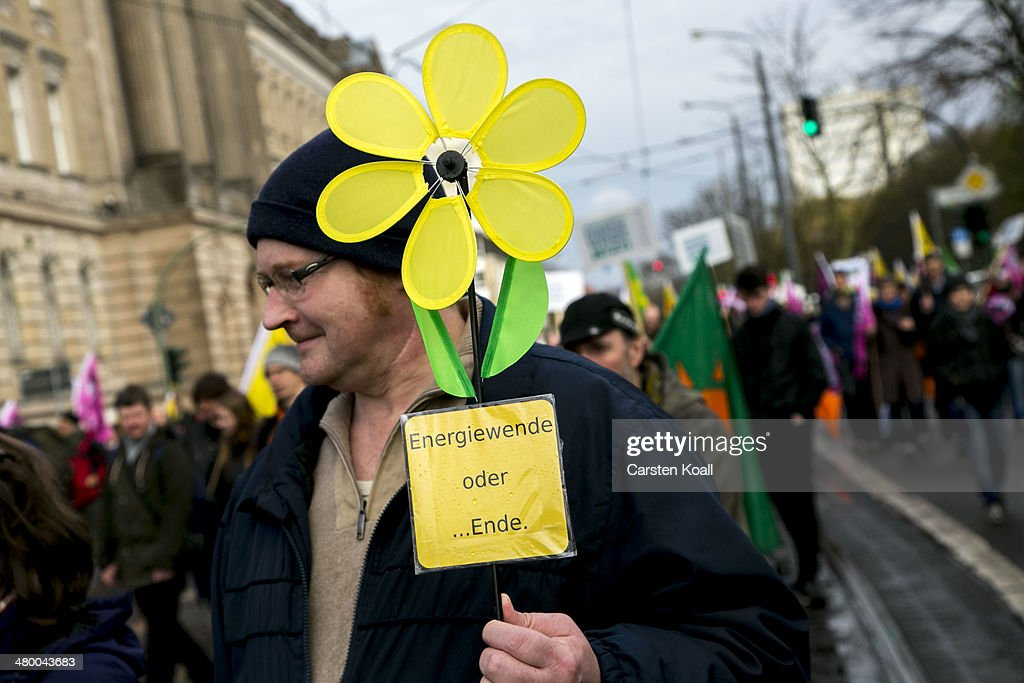 A demonstrator holds a little windmill while demonstrators march to demand a faster transition to renewable energy sources on March 22, 2014 in Postdam, Germany. Similar protests are being held across Germany today as Germany's drive toward covering a higher portion of its energy demands with renewables has faltered recently due to high costs and an incomplete infrastructure.