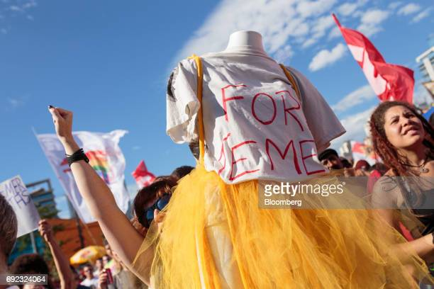A demonstrator holds a mannequin with a tshirt that reads 'Temer Out' during a protest against Brazilian President Michel Temer and government...