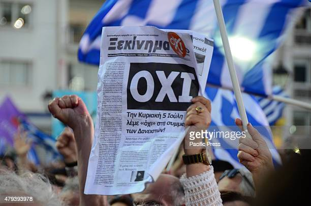 A demonstrator holds a newspaper with the title 'OXI' in Greek A demonstration in Syntagma square in support of a 'NO' vote on the 5th of July...