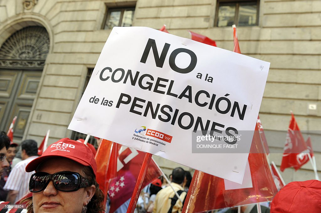 A demonstrator holds a placard reading 'no to the freezing of pension' during a demonstration of thousands of civil servants against the austerity measures of the Spanish government on May 20, 2010 in Madrid. Thousands of public sector workers took to the streets of Spain today to protest a tough government austerity plan aimed at reining in the public deficit and easing fears of a Greek-style debt crisis.