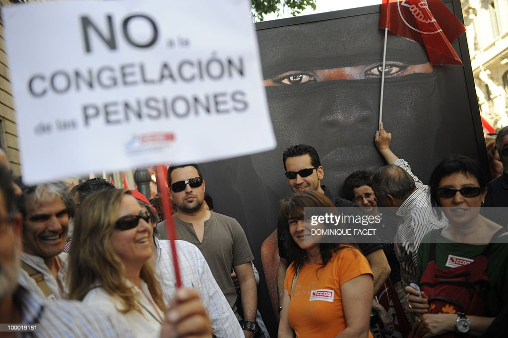 A demonstrator holds a placard reading 'no to the freezing of pensions' during a demonstration of thousands of civil servants against the austerity measures of the Spanish government on May 20, 2010 in Madrid. Thousands of public sector workers took to the streets of Spain today to protest a tough government austerity plan aimed at reining in the public deficit and easing fears of a Greek-style debt crisis.