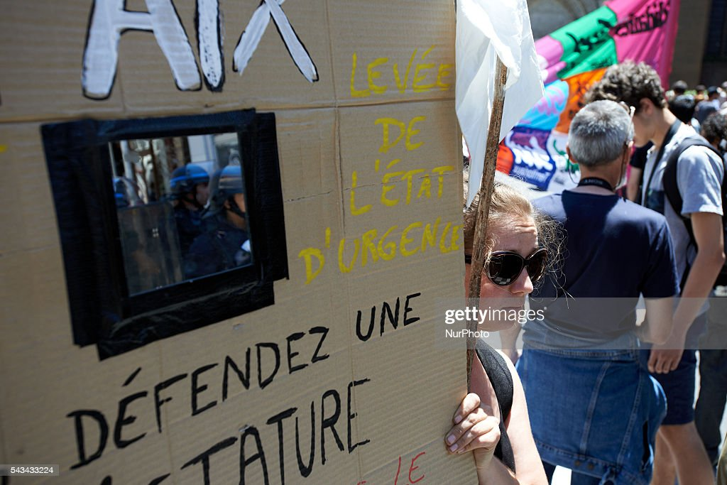 A demonstrator holds a placard with a mirror refecting riot police asking for the end of the state of emergency proclaimed by President François Hollande eight months ago during a protest against the El-Khomri bill on labour reforms the day the bill go through the Senate. They also protest against the use of article 49.3 which bypass the Parliament . Toulouse. France. June 28th, 2016.