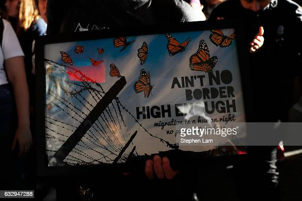 A demonstrator holds a plaque during a rally against a ban on Muslim immigration at San Francisco International Airport on January 28 2017 in San...
