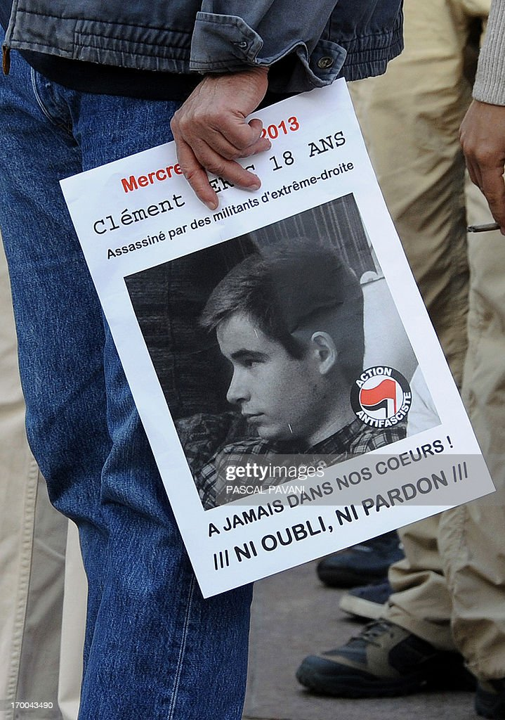 A demonstrator holds a poster of Clement Meric during a rally on June 6, 2013 in the southwestern town of Toulouse after the young far-left activist was killed during a fight with skinheads in central Paris. Clement Meric, an 18-year-old French far-left activist and student at the city's prestigious Sciences-Po university, died on June 6 following the fight. Clement Meric had been left brain dead after the violence on June 5. The police source said three men and one woman had been held and that the attacker who is thought to have dealt the fatal blow denied having an intention to kill. The board reads : 'Murdered by far-right activists, forever in our hearts, neither forget, nor forgive'.