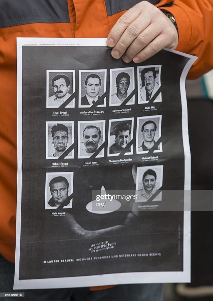 A demonstrator holds a poster with the portraits of victims of a murder spree targeting immigrants during a protest march against racism on November 4, 2012 in Jena, eastern Germany. Twelve months after revelations that a neo-Nazi trio was likely behind the seven-year murder spree in which nine men of Turkish and Greek origin and a German policewoman were killed, Germany has sought to mend security flaws but the trauma still reverberates.